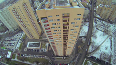 Tall dwelling houses on street with traffic at winter Stock Footage