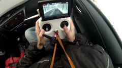 Man uses wireless control unit for quadrocopter Stock Footage