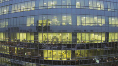 Reflection of street in skyscraper windows with people work Stock Footage