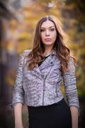 Young beautiful girl fashion shot / autumn scene Stock Photos