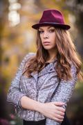 young beautiful girl fashion shot / autumn scene - stock photo