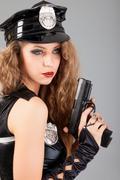 Beautiful sexy police girl with handgun Stock Photos