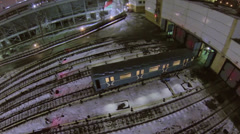 Electric locomotive rides to gate of depot with railroad tracks - stock footage