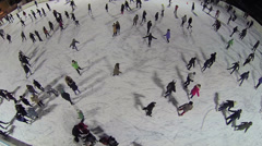 Many young people are skating on ice rink at winter Stock Footage