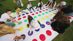 Young people are playing a big twister at International Festival Stock Footage