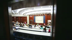 Conference participants Voice of Youth in spacious auditorium - stock footage