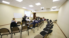 Young people listen to speaker in a small lecture hall Stock Footage