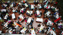 A spacious hall with tables and many young people Stock Footage
