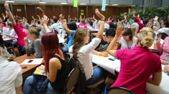 Stock Video Footage of Many young people raise their hands up at Conference Youth Voice