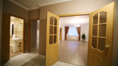 Empty corridor with several doors of the room in new apartment Stock Footage