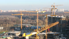 Lots of construction cranes on buildings construction Stock Footage