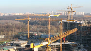 Stock Video Footage of Lots of construction cranes on buildings construction