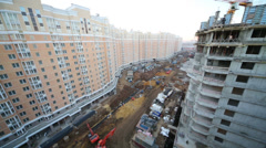 Building under construction next to long multi-storey building Stock Footage