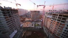 Large high-rise construction with several construction cranes Stock Footage