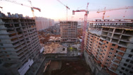 Stock Video Footage of Large high-rise construction with several construction cranes