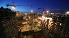 Large construction site of multi-storey buildings in the evening Stock Footage