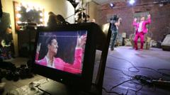 Movie set of musical video clip with dancer in pink suit Stock Footage