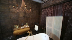 Decorated in a studio room with bath and chandelier Stock Footage