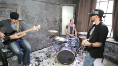 Two guitarists and drummer play in room powdered with snow Stock Footage