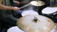 Drummer hits sticks the drums and cymbal covered snow Stock Footage