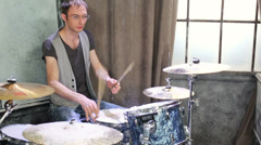 Drummer plays drums in room powdered snow with curtain Stock Footage