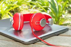 vivid red headphones and laptop - stock photo