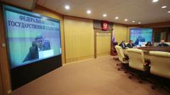 Screen with head of Rosstat Alexander Surinov at conference Stock Footage