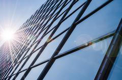 Glass and steel - mirrored facade of modern office building Stock Photos