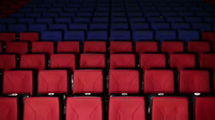Young people sit on their seats in dark hall cinema Stock Footage