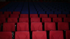 Young cute girl gets out from the seats in cinema hall Stock Footage