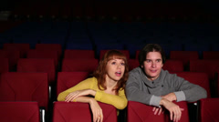 Young man with woman watch movie, embrace and fear in cinema Stock Footage
