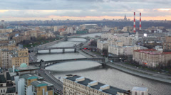 Three bridges over the river and railway station in evening city Stock Footage
