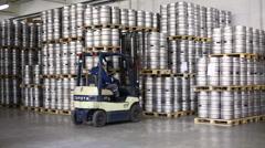 Autoloader loading beer kegs in warehouse of brewery Ochakovo Stock Footage