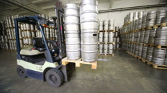 Autoloader standing with beer kegs in warehouse brewery Stock Footage