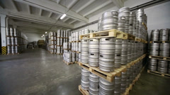 Review large warehouse with rows of metal beer kegs Stock Footage