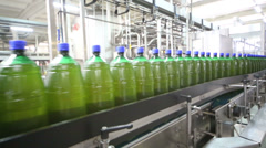 Conveyor with lot green beer bottles in workshop at brewery Stock Footage