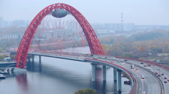 Zhivopisny Bridge is cable-stayed bridge that spans Moskva River Stock Footage