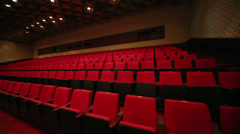 Movement along the rows of comfortable red chairs - stock footage