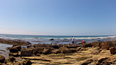 Rocky Tidepool Area And Ocean At Crystal Cove State Park Stock Footage