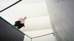 Agile boy jump at walls on the place for parkour training - stock footage