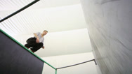 Stock Video Footage of Agile boy jump at walls on the place for parkour training
