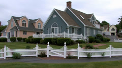Maine seacoast cottage white fence, pan Stock Footage