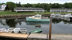 Scenic Maine fishing village boat cove Stock Footage