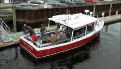 Fishing boat tour group docks Stock Footage