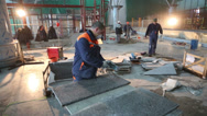 Stock Video Footage of Worker in a respirator grinds tiles at construction of terminal