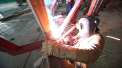 Welders in mask working on construction of terminal at Vnukovo Stock Footage