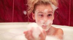 Little girl in the bathroom dealt foam on face like a beard Stock Footage