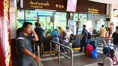 People buy train ticket at train station Stock Footage