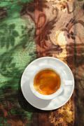 Espresso coffee cup on rustic table with sun Stock Photos