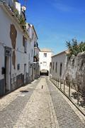 Arched entraceway in Lagos, Algarve, Portugal - stock photo